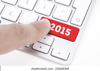 finger pressing keyboard key written 2015 newyear