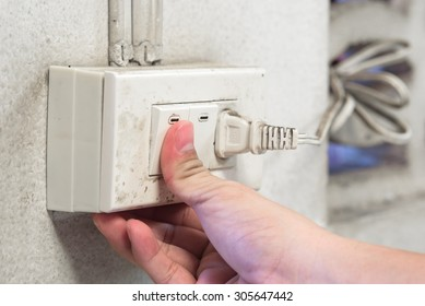 Finger pressing old light switch