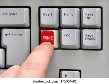 Finger pressing panic button on computer keyboard