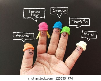 Finger puppets saying thank you in different languages