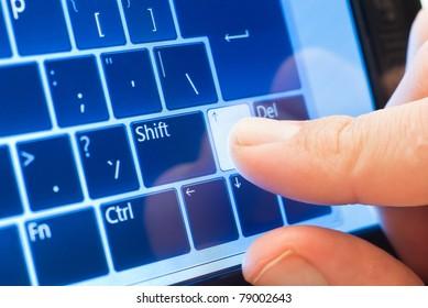 finger push arrow on touch screen virtual keyboard