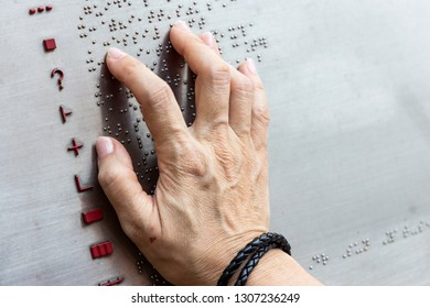 Finger reading braille tactile on public park message board in Hong Kong