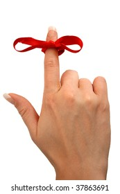 Finger with a red bow tied as a reminder
