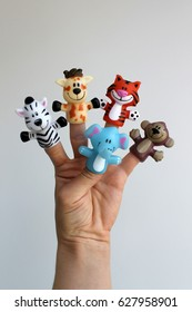 Finger theater. Puppet theater for finger toys animals. Doll is wearing on the fingers of the human hand. Figures of animals, heroes of the puppet theatre which put in the fingers of the hand.