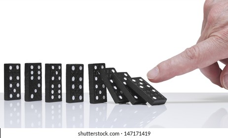 Finger toppling dominoes. Domino effect.
