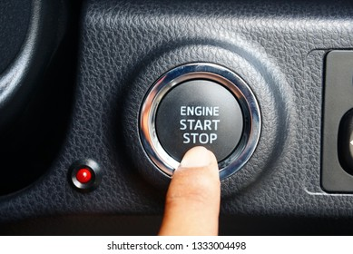 finger touch engine start button - Image