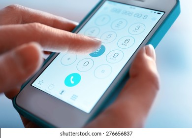 Finger touch number on smartphone to make a call, close up