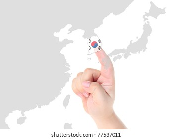 Finger touch on a future innovative transparent touch screen Korea map and flag
