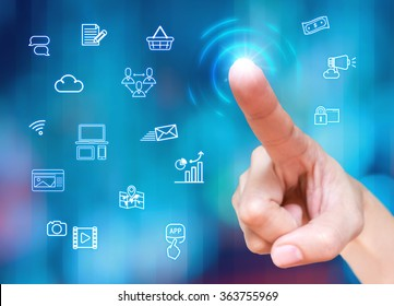 Finger touch on screen with Digital marketing feature icon at blur blue background,technology concept