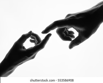 Finger Touching hands silhouette man woman white background couple feeling love. Black and white photo picture