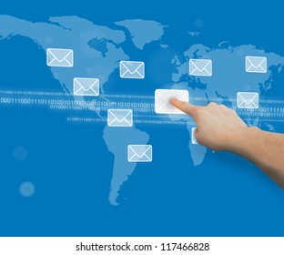 Finger touching message symbol against blue world map touchscreen interface with binary code