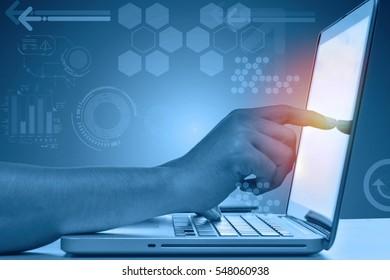 Finger touching screen of laptop