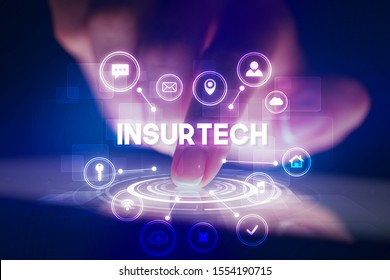 Finger touching tablet with web technology icons and INSURTECH inscription, web technology concept
