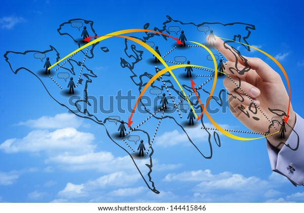 Finger touching a virtual map of an international social network made of members from all over the world, with the sky as background