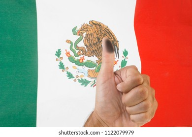 Finger voting with Mexico flag background. Mexico Elections 2018, elecciones Mexico 2018, spanish text