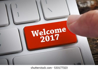 """Finger at """"Welcome 2017"""" On Keyboard Button"""