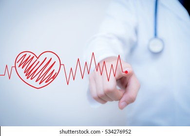 finger write red heart with the heart is a part of a cardiogram, Concept of medical examination.