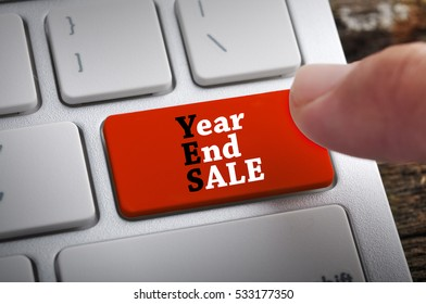 """Finger at """"Year End Sales"""" On Keyboard Button"""