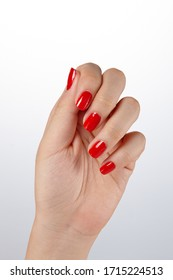 fingernails painted in glossy red.
