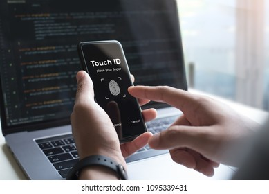 Fingerprint scanner security verify on mobile smart phone. Man, software engineer holding smartphone touch ID fingerprint on screen, personal identification, cyber security, ai artificial intelligence