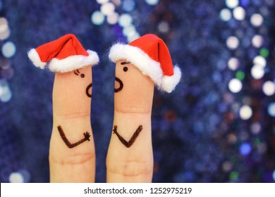 Fingers art of couple celebrates Christmas. Concept of a man and woman yelling at each other in New Year. Toned image.