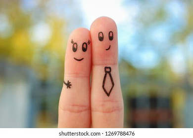 Fingers art of couple. Concept of office romance.