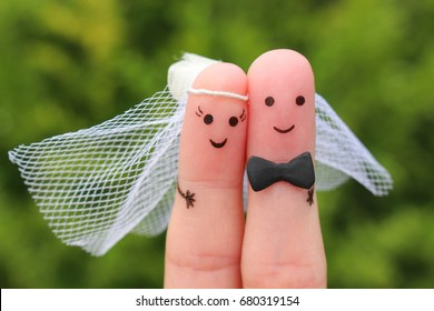 Fingers art of happy couple to get married. Concept of wedding ceremony.