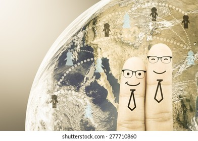 Fingers business man on earth background , Elements of image are furnished by NASA