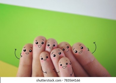 Fingers decorated as a group of friends. They are happy.