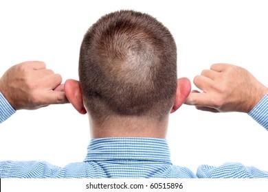Fingers in Ear. Not listening