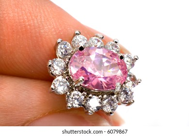 Fingers holding a beautiful Jewel ISOLATED