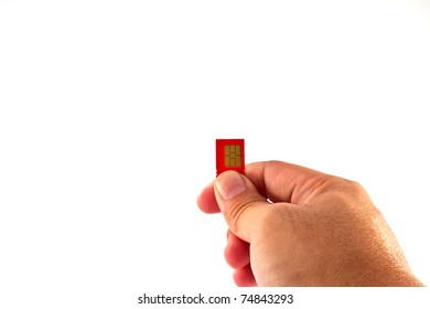 Fingers holding a mobile phone GSM SIM Card. Isolated on white background