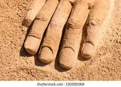 Fingers from the left Hand drawn in the sand on the beach