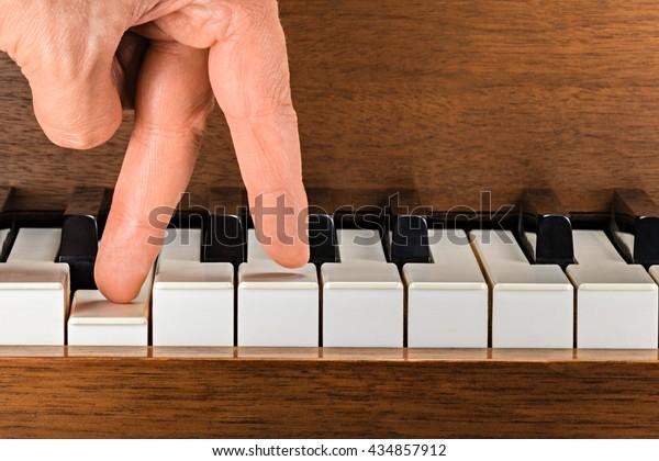 Fingers on piano keys
