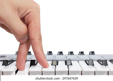fingers on piano keys, isolated on white. concept = start playing & keep walking to destination of music life