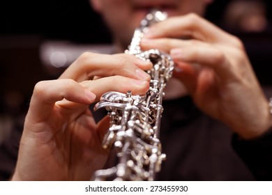 The fingers of the person playing the oboe closeup