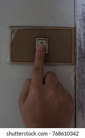 Fingers pressing power switch off