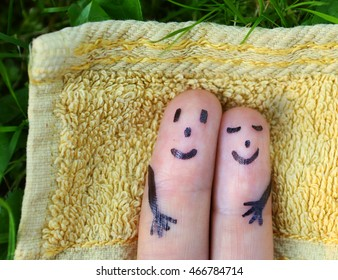 fingers represent loving couple sunbathing under the sun close up photo