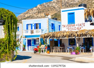 FINIKI PORT, KARPATHOS ISLAND - SEP 25, 2018: Typical Greek tavern in Finiki port on Karpathos island. Greece is very popular holiday destination in Europe.