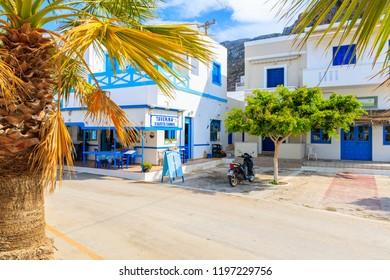 FINIKI PORT, KARPATHOS ISLAND - SEP 30, 2018: Typical Greek tavern on street of Finiki village, Karpathos island, Greece.