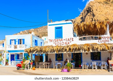 FINIKI PORT, KARPATHOS ISLAND - SEP 25, 2018: Typical Greek tavern in Finiki port on Karpathos island. Greece is very popular holiday destination in Europe.