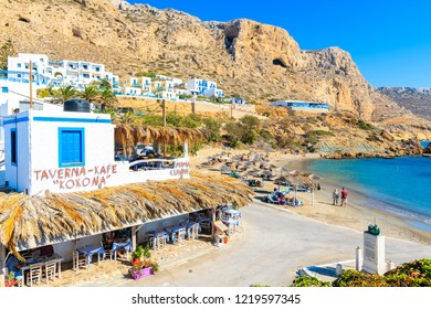 FINIKI PORT, KARPATHOS ISLAND - SEP 25, 2018: Typical Greek taverns in Finiki port on Karpathos island. Greece is very popular holiday destination in Europe.