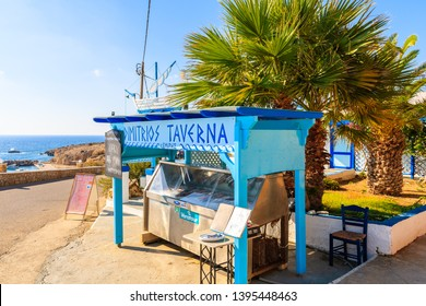 FINIKI PORT, KARPATHOS ISLAND - SEP 25, 2018: Stand presenting fresh fish to eat in taverna restaurant in village on coast of Karpathos island, Greece.