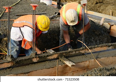 Finish work as workers are pouring a foundation for a new commercial building in Roseburg Oregon