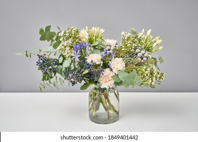Finished flower arrangement in a vase for home. Flowers bunch, set for interior. Fresh cut flowers for decoration home. European floral shop. Delivery fresh cut flower.