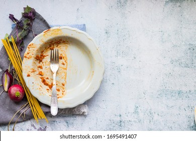 Finished food in dirty, unclean, empty dish after vegan lunch or vegetarian dinner. Leftover pieces of meal on plate to be clean. Copy space