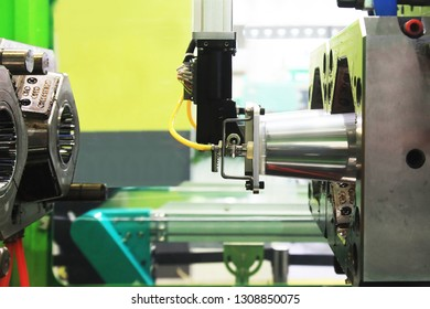 The finished part is removed from the injection molding machine vacuum robot