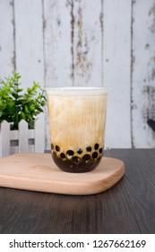 Finished pearl milk tea in a cup