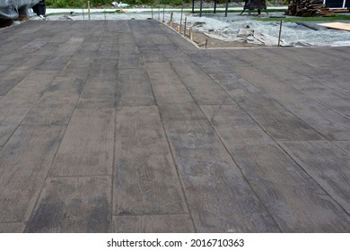 A finished stamped concrete patio floor