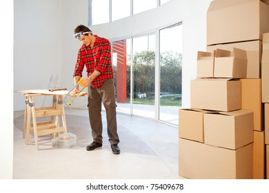 A finishing carpenter cutting wood in a house